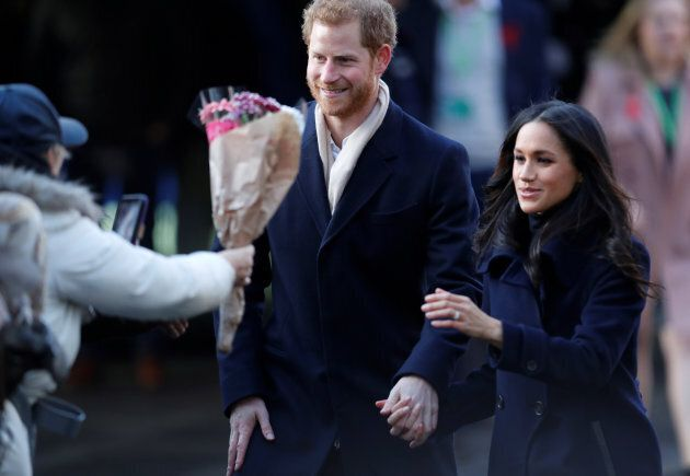 Prince Harry and Meghan Markle greet well wishers as they arrive at an event in Nottingham, Dec. 1,