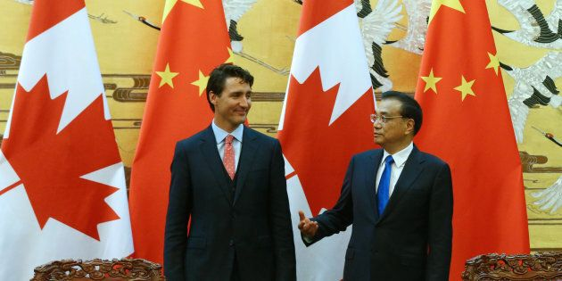 Chinese Premier Li Keqiang and Prime Minister Justin Trudeau talk at the Great Hall of the People in...