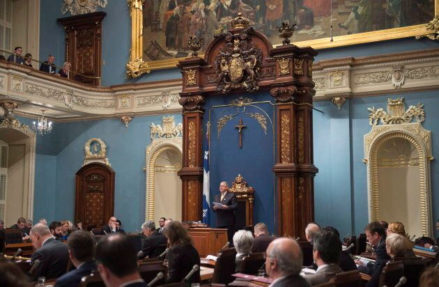 Quebec Legislature Speaker Jacques Chagnon reads a decision on whether police could arrest or search...