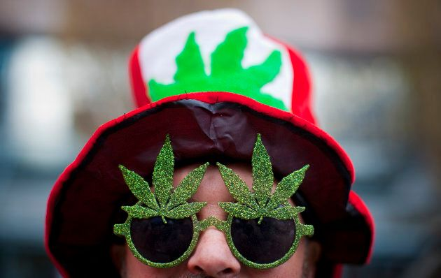 A man, wearing a marijuana-themed hat and sunglasses, is pictured at the Vancouver Art Gallery during the annual 4/20 day, which promotes the use of marijuana, in Vancouver, April 20, 2013.