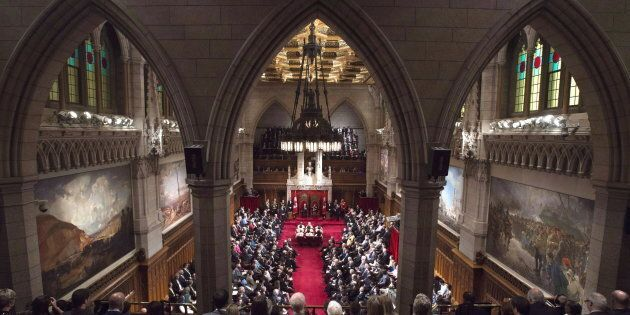 Former governor general David Johnston delivers the speech from the throne in the Senate Chamber on Parliament...
