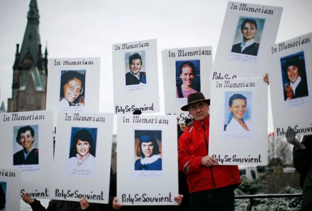 Demonstrators hold portraits of some of the victims of the Montreal Massacre during the National Day...