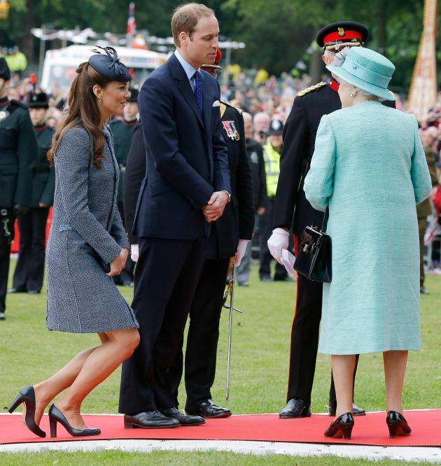 Catherine, Duchess of Cambridge curtsies to Queen