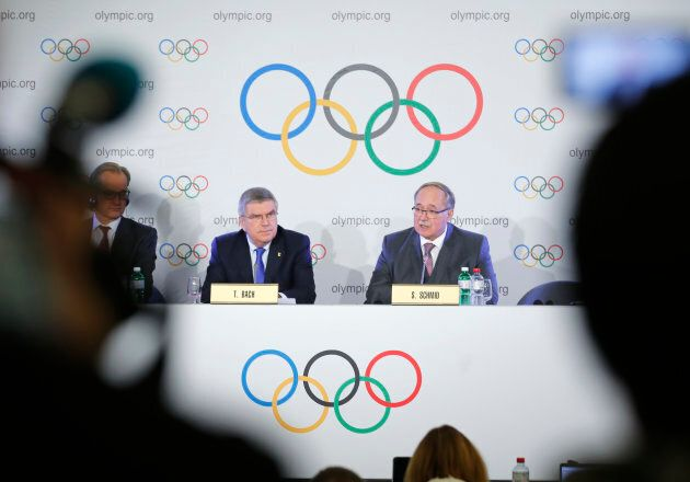 Samuel Schmid, chair of the IOC Disciplinary Commission, and Thomas Bach, president of the International...