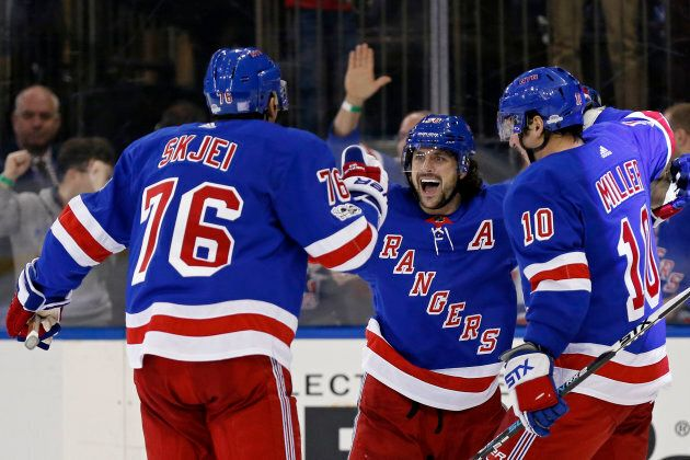 New York Rangers right wing Mats Zuccarello (36) celebrates scoring the game-winning goal against the...