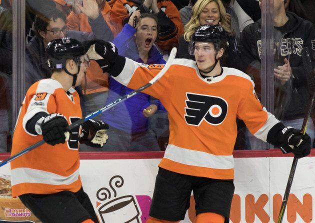 Philadelphia Flyers center Nolan Patrick (19) celebrates his goal with defenseman Ivan Provorov (9) during...
