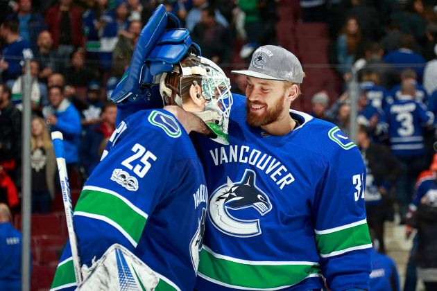 Anders Nilsson (31) of the Vancouver Canucks congratulates Jacob Markstrom (25) after their NHL game...