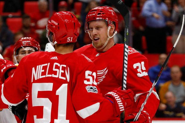 Detroit Red Wings right wing Anthony Mantha (39) receives congratulations from center Frans Nielsen (51)...