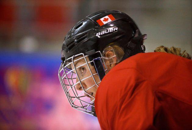 Hayley Wickenheiser watches teammates during a women's ice hockey team practice at the 2014 Sochi Winter...
