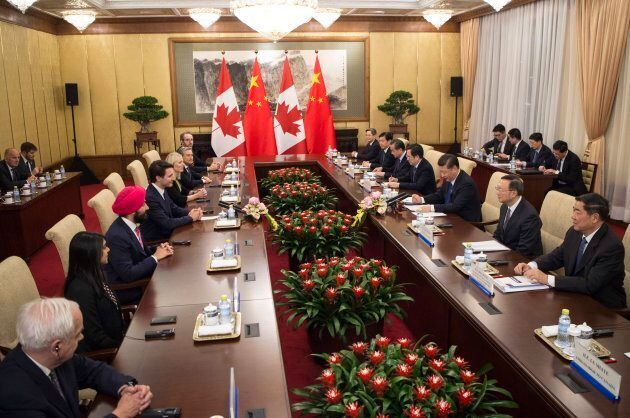 Prime Minister Justin Trudeau, fourth from left, speaks to Chinese President Xi Jinping, third from right,...