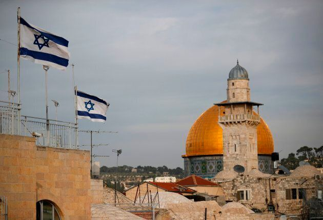 Israeli flags fly near the Dome of the Rock in the Al-Aqsa mosque compound on Dec. 5,