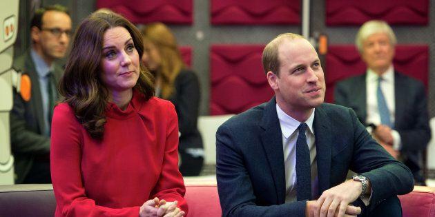 The Duke and Duchess of Cambridge listen to a presentation before speaking to school children at MediaCityUK...