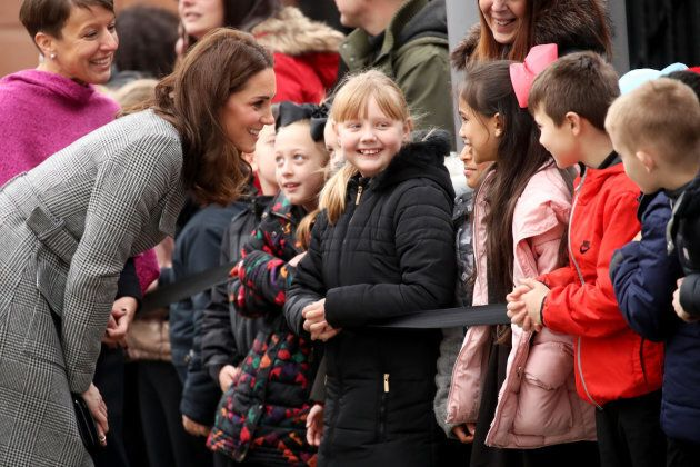 The Duchess of Cambridge talks to children as she attends a 'Stepping Out' session at Media City on Dec.