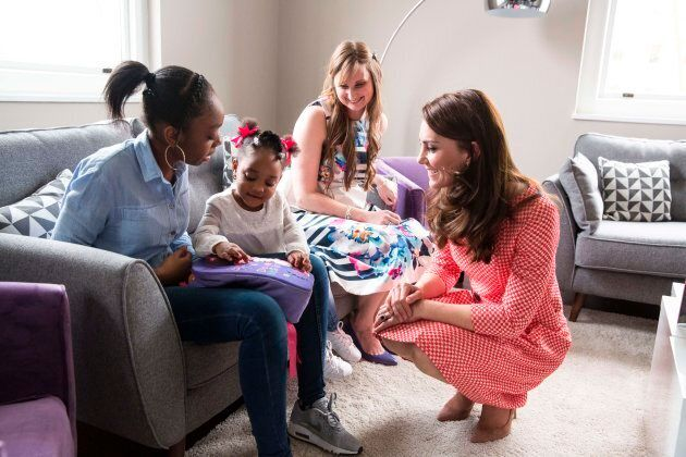 Britain's Catherine, Duchess of Cambridge, right, during a meeting with a parent support group while...