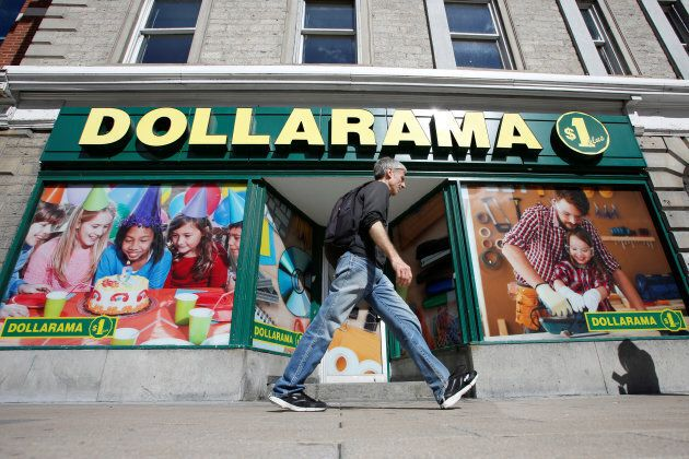 A pedestrian walks past a Dollarama store in Ottawa, Sept. 1,