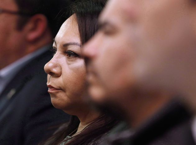 Sheila North Wilson, grand chief of Manitoba Keewatinowi Okimakanak, listens to an RCMP announcement...