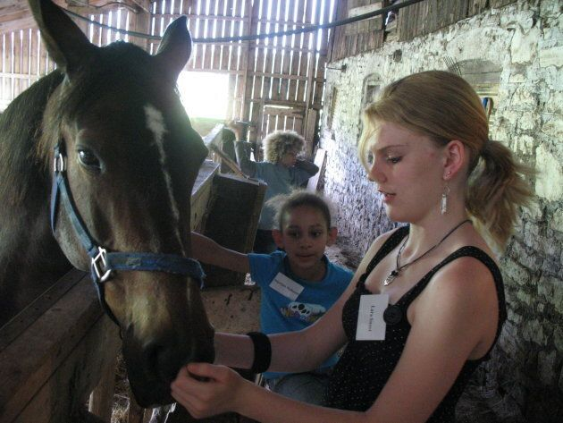 Lara Sweet is shown at a horse farm in