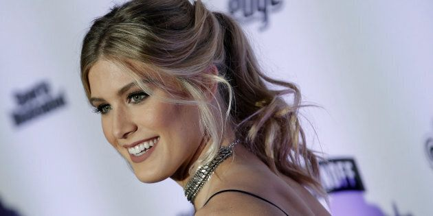 Tennis player and model Eugenie Bouchard poses for photographers at a launch event for the Sports Illustrated Swimsuit Issue in New York on Feb. 16, 2017.