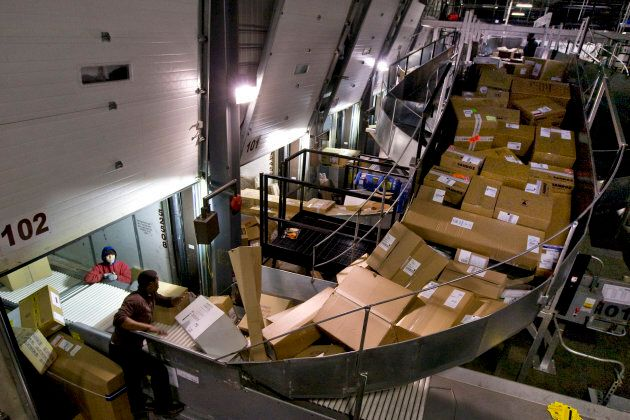 Workers route packages at the UPS sorting facility near Toronto on Dec. 17,