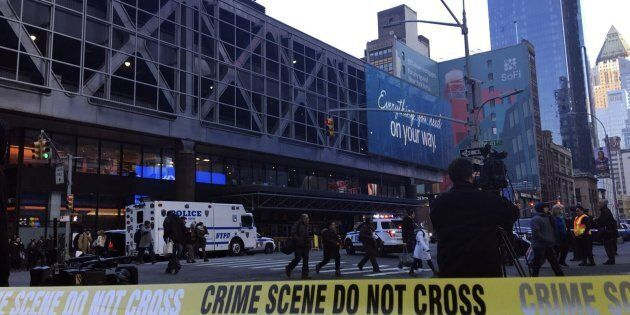 New York Police Department officers take security measures after an explosion occurred on Dec. 11,