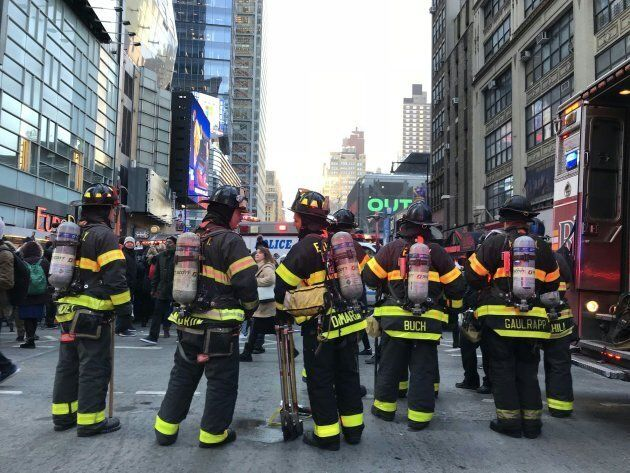 Firefighters gather at the site of a blast in New York City on Dec. 11,