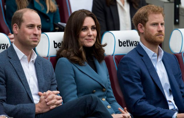 The Duke and Duchess of Cambridge with Prince Harry at the Coach Core graduation ceremony at London Stadium on Oct. 18, 2017.