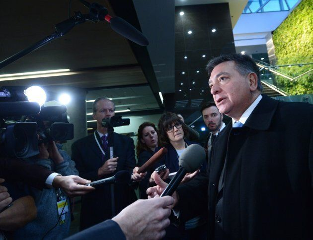 Ontario Finance Minister Charles Sousa speaks to members of the media as he arrives for meetings with...