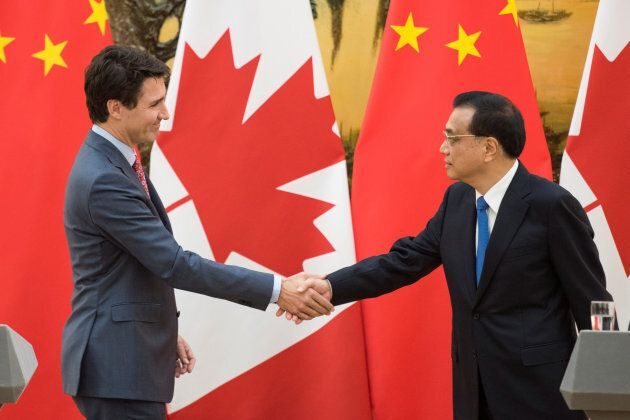 Prime Minister Justin Trudeau and Chinese Premier Li Keqiang shake hands during a news conference meeting at the Great Hall of the People in Beijing on Dec. 4, 2017.