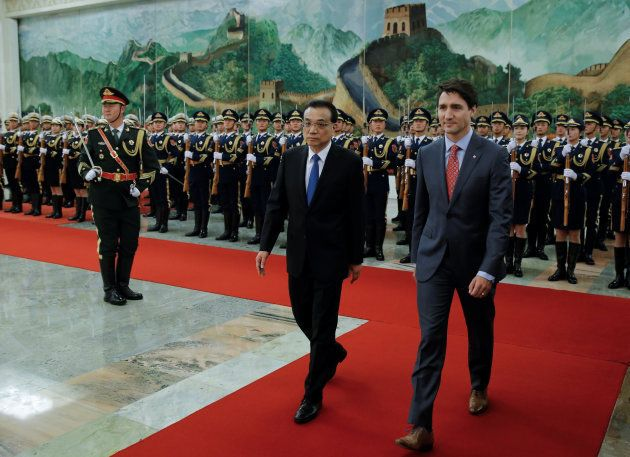 Prime Minister Justin Trudeau and Chinese Premier Li Keqiang attend a welcoming ceremony at the Great Hall of the People in Beijing, on Dec, 4, 2017.