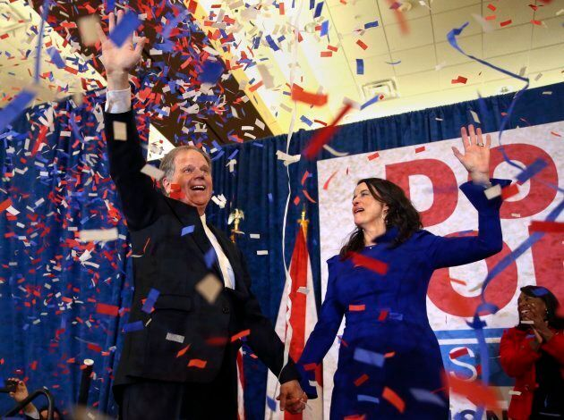 Democratic candidate for U.S. Senate Doug Jones and his wife Louise wave to supporters before speaking...
