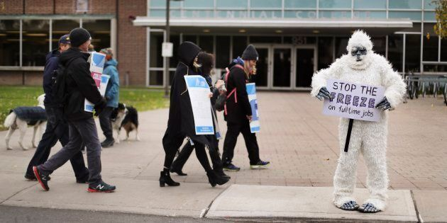 An instructor is dressed up as a Yeti while she walks the picket line at the East York Centennial College...