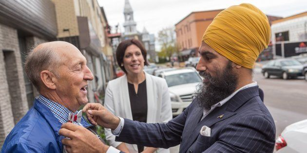 NDP Leader Jagmeet Singh talks with a passerby as he visits Alma in the riding of Lac St-Jean on Oct....