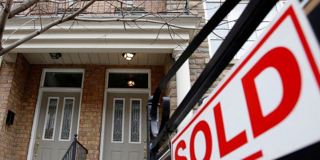 A sold sign is displayed in front of a home in Toronto Dec.15, 2009. A new stress test for homebuyers...