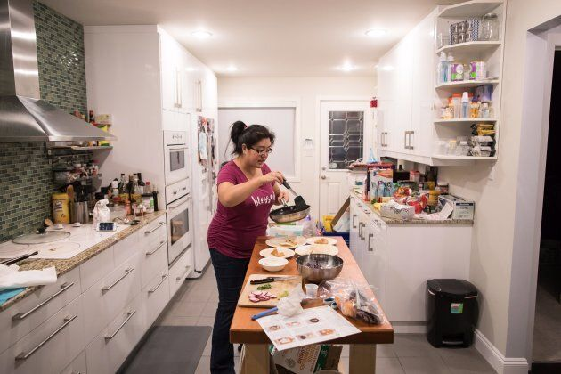 Jayne Zhou prepares cajun fish tacos from a Hello Fresh meal kit, at her home in Vancouver, B.C., on...