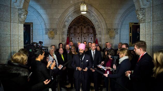 NDP Leader Jagmeet Singh is joined by members of his party as they hold press conference on Parliament Hill in Ottawa on Dec. 13, 2017.