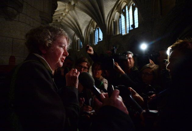 Ethics Commissioner Mary Dawson speaks to reporters after appearing as a witness at a commons committee...