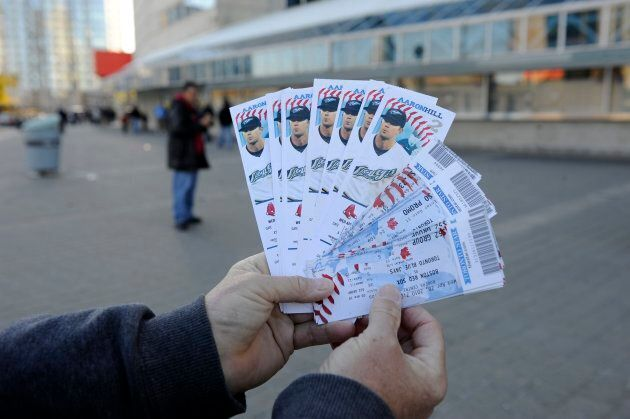 A scalper shows off a handful of tickets he claimed were