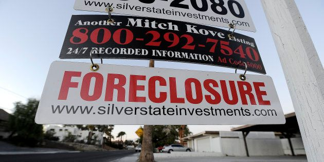 A foreclosure sign is seen in front of a bank-owned home for sale in Las Vegas, Nev., Nov. 8, 2010, in...