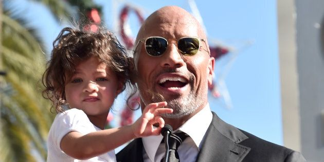 Dwayne Johnson and his daughter Jasmine at the Hollywood Walk of Fame on Dec. 13, 2017.