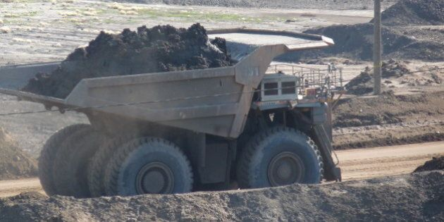 A truck hauling oil sands extraction at the Syncrude Mildred Lake mine, Fort McMurray,