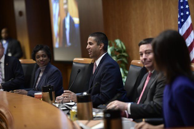 FCC Chairman Ajit Pai speaks during a hearing at the Federal Communications Commission, after it was briefly interrupted and evacuated by police due to security reasons on Thursday.