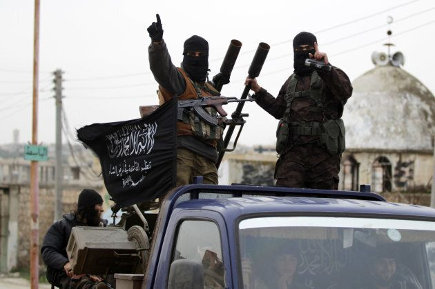 Members of al-Qaeda's Nusra Front drive in a convoy touring villages in the southern countryside of Idlib, on Dec. 2, 2014.