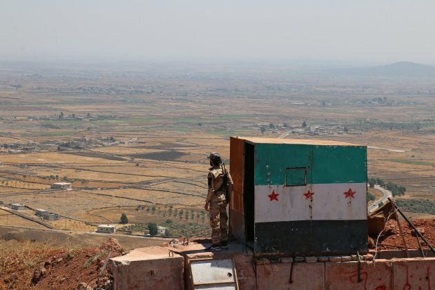 A Free Syrian Army fighter in the Quneitra countryside on Aug. 24,