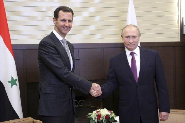 Russian President Vladimir Putin shakes hands with Syrian President Bashar al-Assad during a meeting in the Black Sea resort of Sochi, Russia, on Nov. 20, 2017.