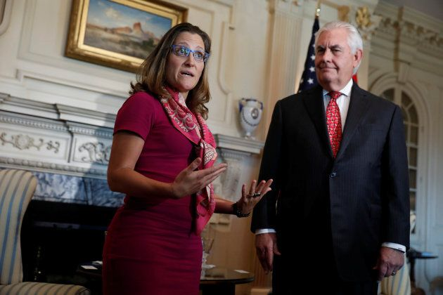U.S. Secretary of State Rex Tillerson looks on as Canadian Foreign Minister Chrystia Freeland speaks...