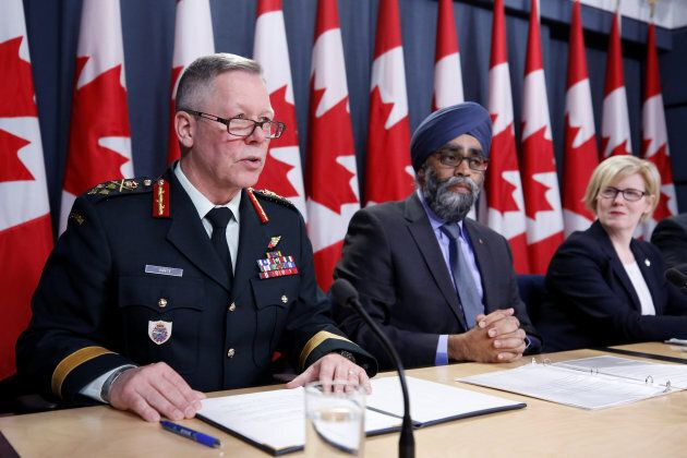 Canada's Chief of the Defence Staff General Jonathan Vance, far left, speaks during a news conference...