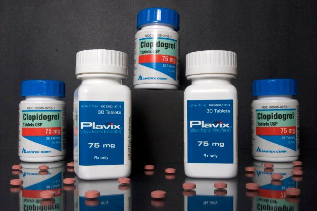 Bottles of Plavix heart pills manufactured by Sanofi-Aventis and Bristol-Myers Squibb, are pictured with...