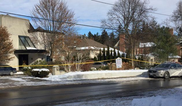 Police tape surrounds the home of billionaire Barry Sherman on
