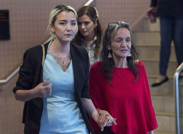 Miriam Saunders walks with her daughter Delilah from the National Inquiry into Missing and Murdered Indigenous...
