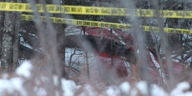 A Hydro One helicopter can be seen at the crash site near Tweed, Ont., on Dec. 14,
